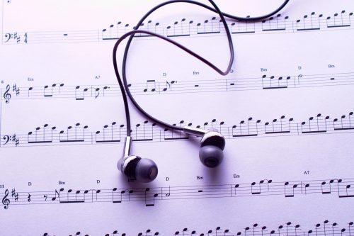 Sheet music and headphones.